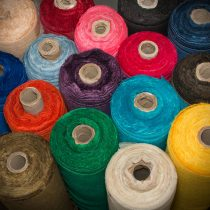 jute fabric on a roll in various colours